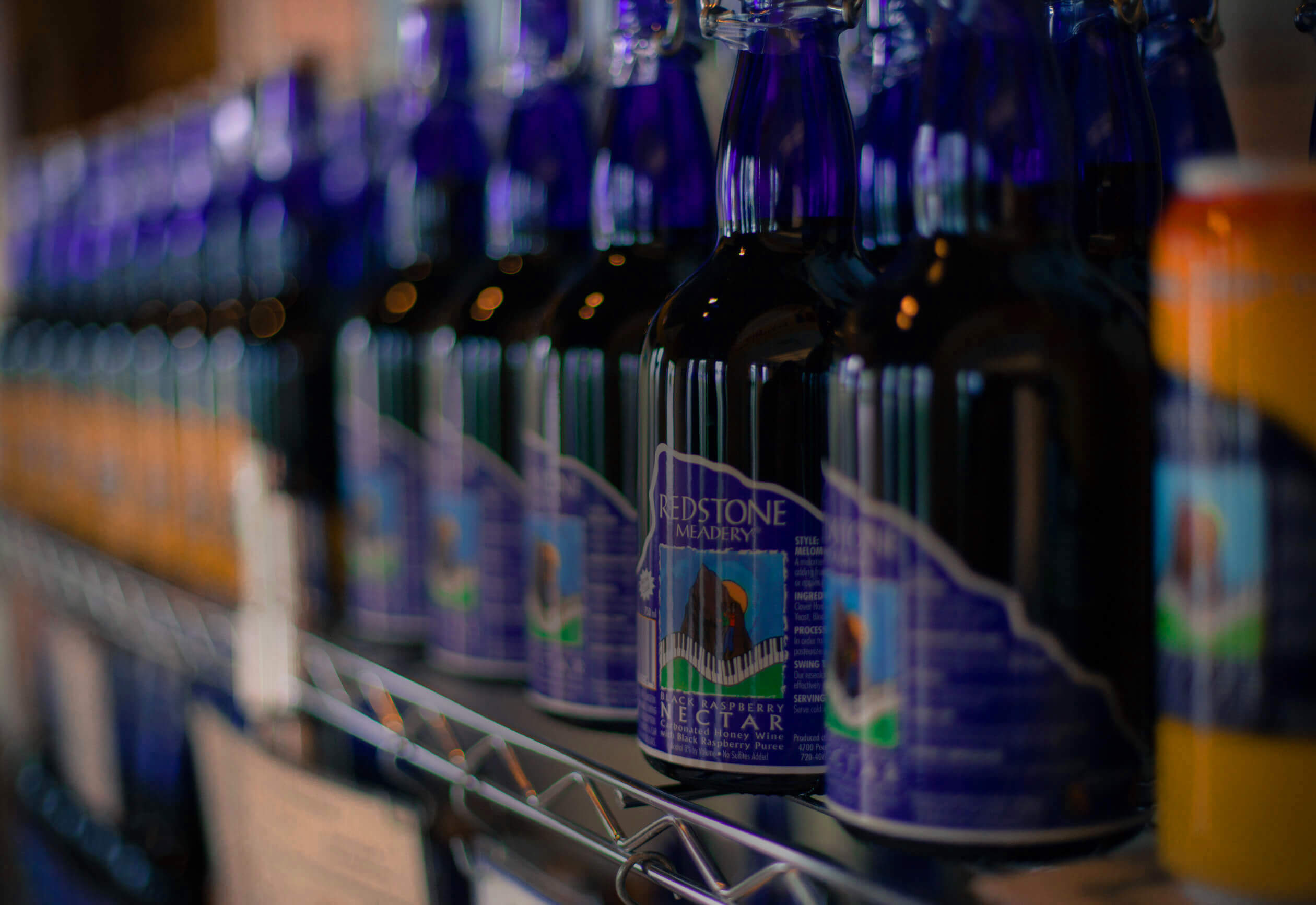 Blue bottles of mead on a shelf